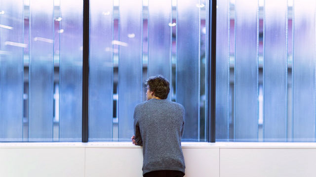 A man thinking before window