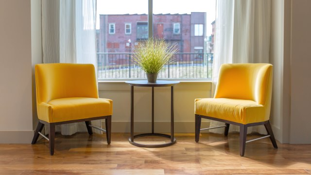 Two yellow sofas in a room