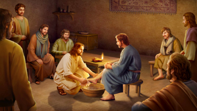 Jesus washes his feet for the disciples