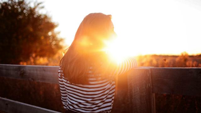 Girl watching the sunrise