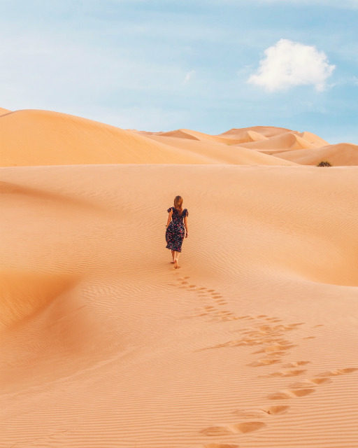 a woman walking in the desert
