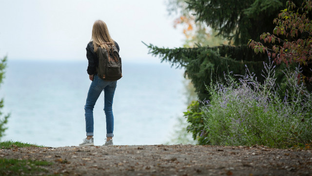 A girl looks at the distance again