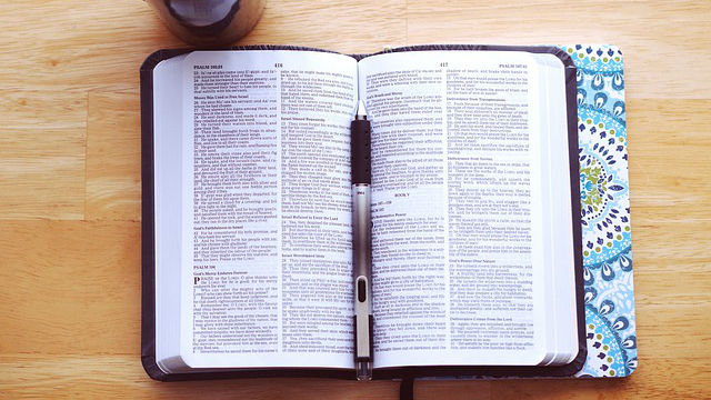 a pen on top of the Bible