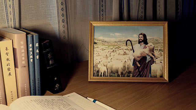Framed picture of Jesus on a desk