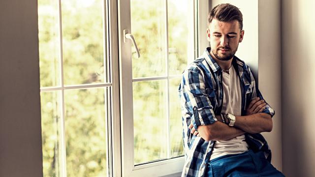 Handsome man sitting near window